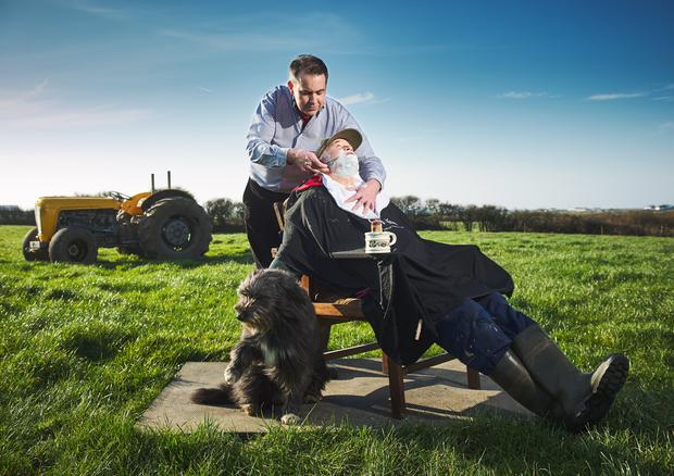 Former barber Joseph Woulfe with his uncle and neighbour Alan Woulfe on his farm at Quilty in county Clare. Photograph of John Kelly.