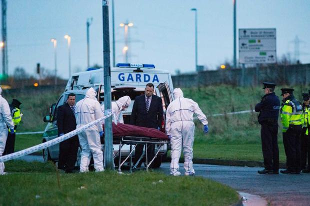 The body of the victim is removed from the scene at Foxdene area of Clondalkin, Dublin 22