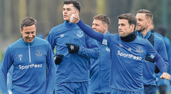 Blue is the colour: Ireland defender Seamus Coleman gives a thumbs-up as he leads his Everton teammates during the warm-up before training yesterday