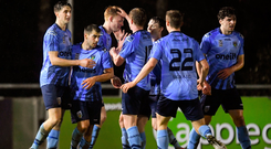UCD players celebrate their first goal scored by Conor Davis