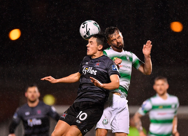 Jamie McGrath of Dundalk in action against Greg Bolger of Shamrock Rovers