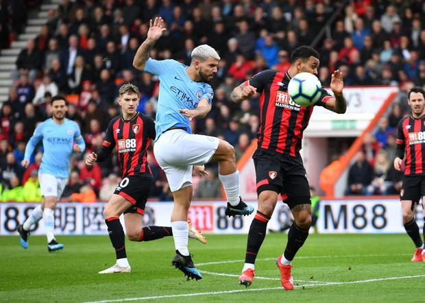 Manchester City's Sergio Aguero in action with Bournemouth's Joshua King
