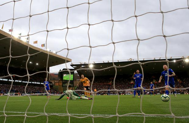 Wolverhampton Wanderers' Diogo Jota scores his side's first goal. Photo credit should read: Nick Potts/PA Wire