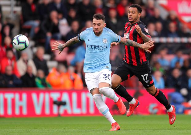 Manchester City's Nicolas Otamendi is challenged by Bournemouth's Joshua King. Photo: Getty Images