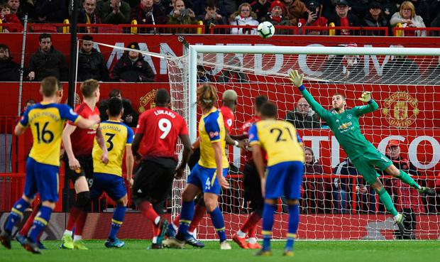 Southampton's James Ward-Prowse watches as his free kick beats Manchester United goalkeeper David de Gea. Photo: Getty Images