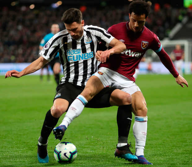 Newcastle's Fabian Schar battles for possession with West Ham's Felipe Anderson. Photo: Getty Images
