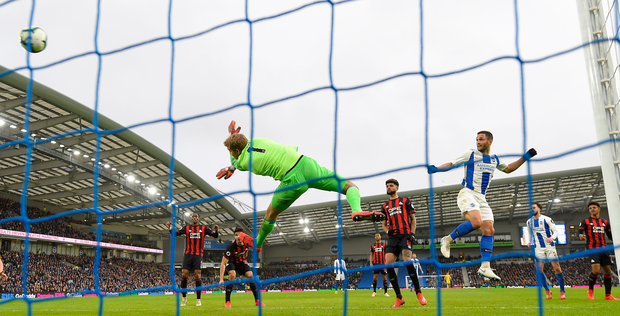 Brighton's Florin Andone heads past Huddersfield's Jonas Lossl. Photo: Getty Images