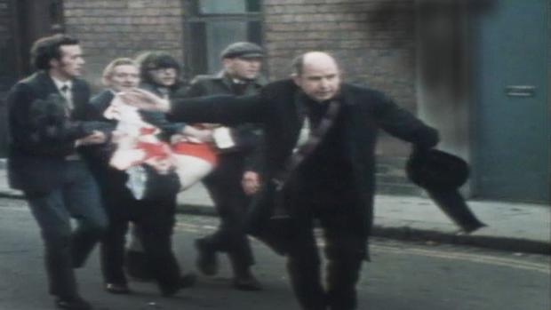 Fr Edward Daly waves a white handkerchief as he tries to escort 17-year-old Jackie Duddy. Duddy died of his injuries soon after and Daly administered the last rites