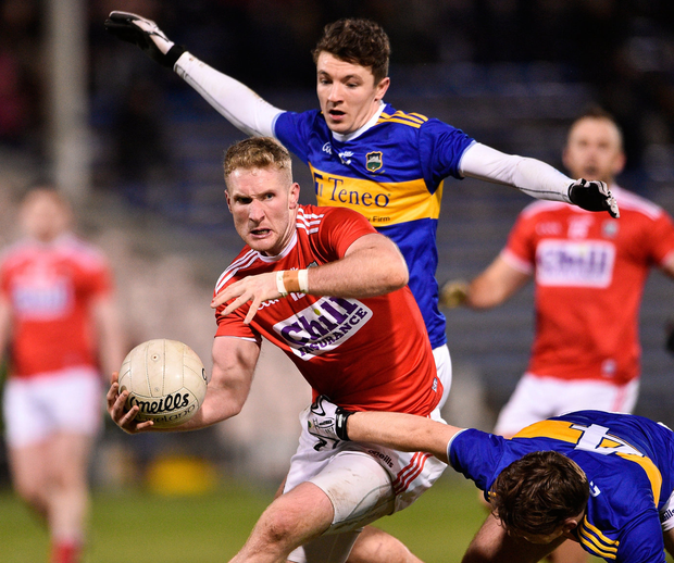Ruairi Deane of Cork in action against Emmett Moloney, right, and Jack Kennedy of Tipperary. Photo: Matt Browne/Sportsfile