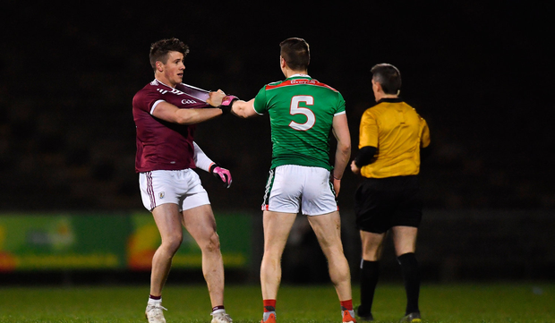 Lee Keegan of Mayo tangles with Shane Walsh of Galway
