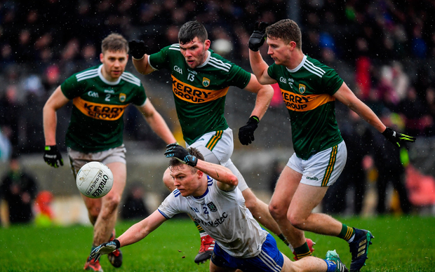 Conor McCarthy of Monaghan in action against Kerry players, from left, Peter Crowley, Kevin McCarthy and Gavin Crowley
