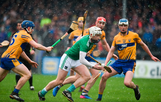 Cian Lynch of Limerick in action against Podge Collins, left, and Diarmuid Ryan of Clare