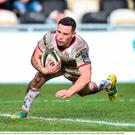 John Cooney of Ulster dives over to score his side's third try