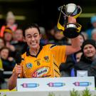 Paula Gribben lifts the trophy after Clonduff's victory. Photo: Harry Murphy/Sportsfile