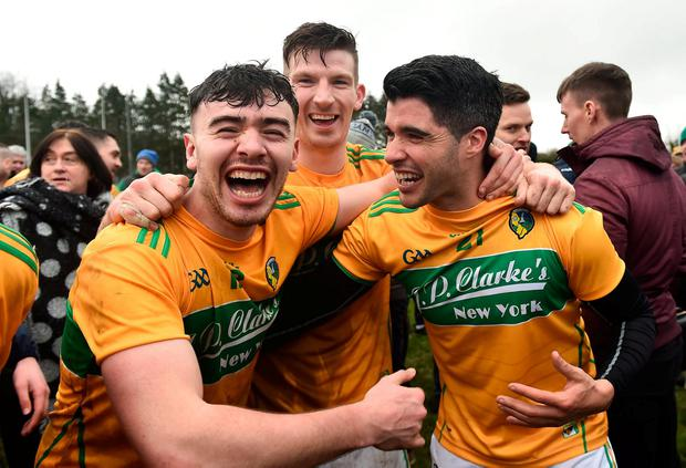 Leitrim players Dean McGovern (left), Shane Quinn and Emlyn Mulligan celebrate their promotion in Carrick-on-Shannon. Photo: Oliver McVeigh/Sportsfile