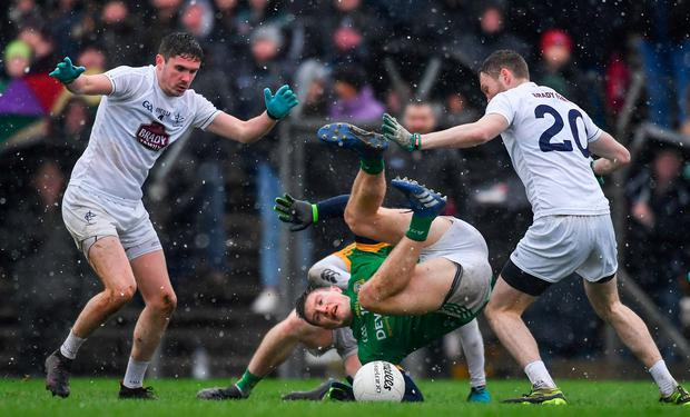 Thomas O'Reilly of Meath takes a tumble while surrounded by David Hyland (left) and James Murray of Kildare. Photo: Piaras Ó Mídheach/Sportsfile