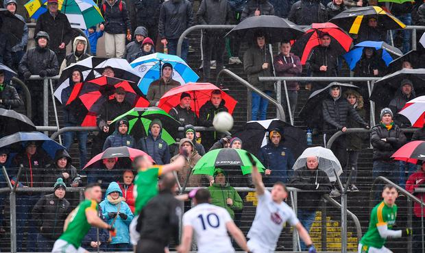 A general view of the spectators during harsh weather conditions at Páirc Táilteann, in Navan, Meath. Photo: Piaras Ó Mídheach/Sportsfile