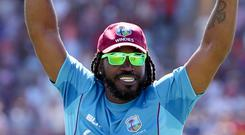 West Indies' Chris Gayle celebrates at the end of the fifth One Day International cricket match against England. Photo: AP Photo/Ricardo Mazalan