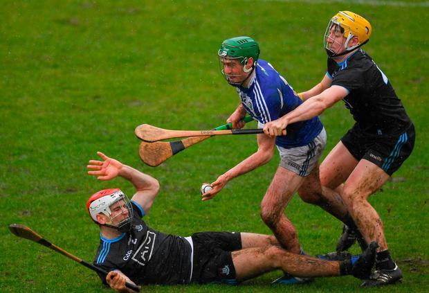 Paddy Purcell tries to pass the sliotar under pressure from Dublin's Paddy Smyth (left) and Dáire Gray. Photo: Ray McManus/Sportsfile