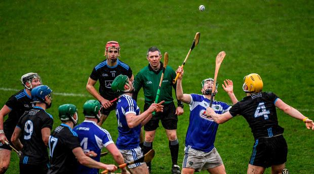 Dublin's Dáire Gray in action against Daniel Comerford and Paddy Purcell of Laois. Photo: Ray McManus/Sportsfile