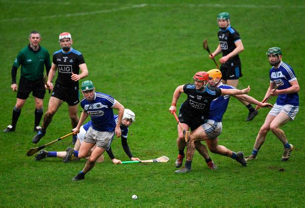 Seán Downey, left, of Laois and Dublin's David Treacy chase for possession. Photo: Ray McManus/Sportsfile