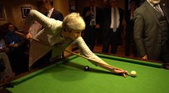 Theresa May playing pool