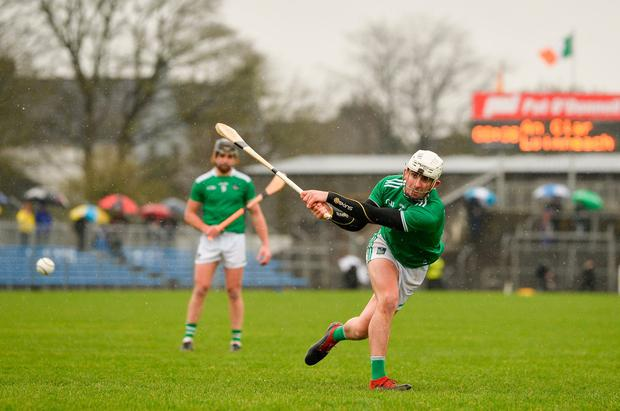 Eyes on the prize: Limerick's Aaron Gillane unleashes a shot during yesterday's draw with Clare in Ennis. Photo: Diarmuid Greene/Sportsfile