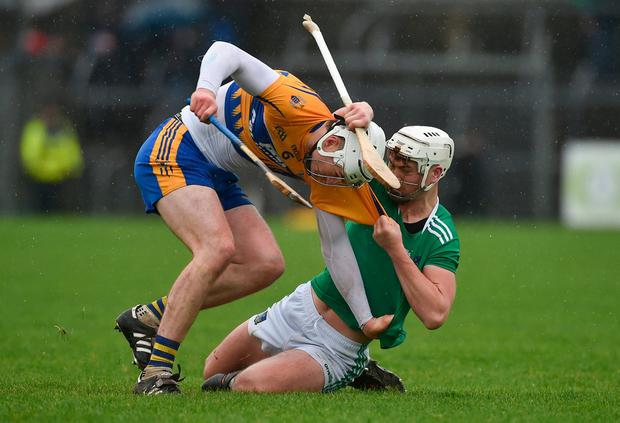 Clare's Conor Cleary and Kyle Hayes of Limerick tussle off the ball. Photo: Diarmuid Greene/Sportsfile