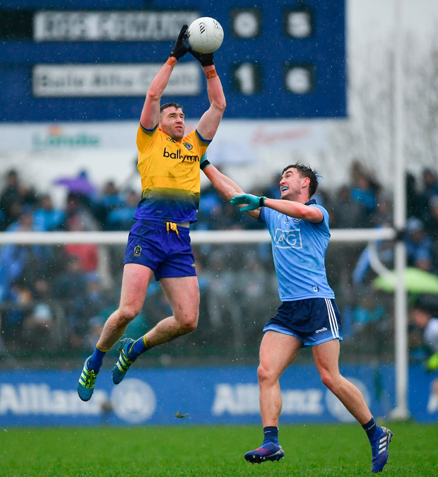 Roscommon's Cathal Cregg plucks the ball out of the air under pressure from Dublin's Andrew McGowan. Photo: Ramsey Cardy/Sportsfile