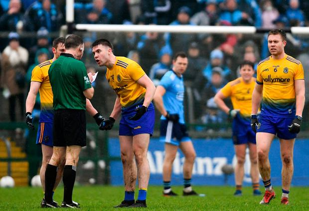 Conor Daly of Roscommon remonstrates with referee Padraig O'Sullivan before being shown a yellow card. Photo: Ramsey Cardy/Sportsfile
