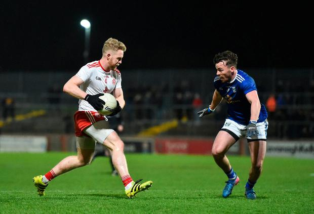 Tyrone's Frank Burns looks for a way around Conor Moynagh. Photo: Seb Daly/Sportsfile