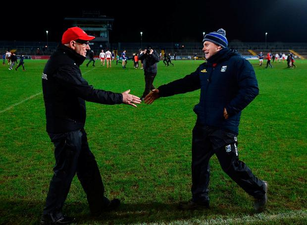 Tyrone manager Mickey Harte, left, and Cavan manager Mickey Graham shake hands at the final whistle. Photo: Seb Daly/Sportsfile