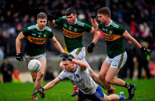 Conor McCarthy of Monaghan comes under pressure from the Kerry trio of Peter Crowley, Kevin McCarthy (centre) and Gavin Crowley. Photo: Brendan Moran/Sportsfile