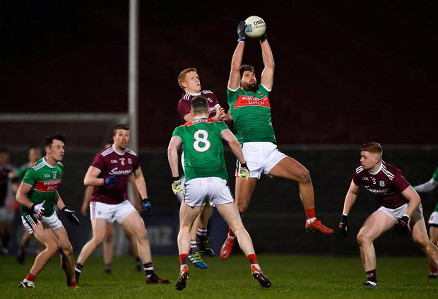 Aidan O'Shea of Mayo catches a kick-out ahead of Galway's Ciarán Duggan. Photo: Piaras Ó Mídheach/Sportsfile