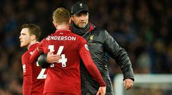 Central issue: Liverpool boss Jurgen Klopp with midfielder Jordan Henderson after yesterday's 0-0 draw on Merseyside. Photo: AFP/Getty Images