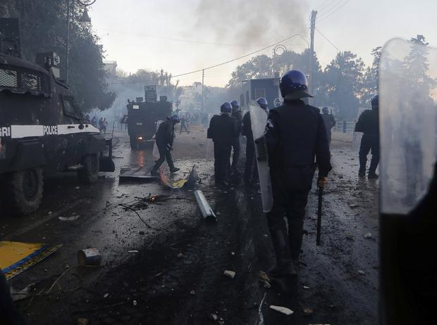 Anti-riot police officers clash with people protesting against President Abdelaziz Bouteflika's plan to extend his 20-year rule by seeking a fifth term in April elections in Algiers. Photo: REUTERS/Zohra Bensemra