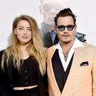Amber Heard (L) and Johnny Depp attend the