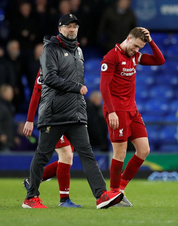 Liverpool manager Jurgen Klopp and Jordan Henderson look dejected at the end of Everton draw