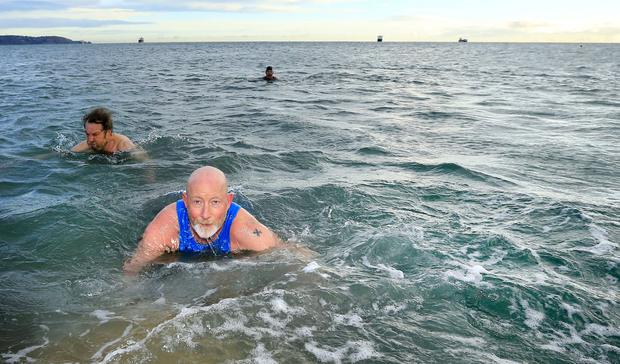 David O'Reilly who is doing a charity swim and then walk to Galway to raise funds for Crumlin Children Hospital, pictured as he takes an early morning dip in the forty foot in Sandycove. Picture; Gerry Mooney