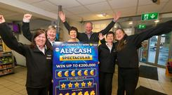 Michael Blanchfield and wife Alice, owners of the Blanchfields Centra Store in Mooncoin, Co. Kilkenny celebrate with staff after they sell a winning scratch card