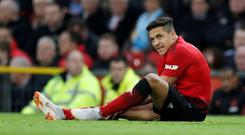 Manchester United's Alexis Sanchez reacts after sustaining an injury. Action Images via Reuters/Carl Recine