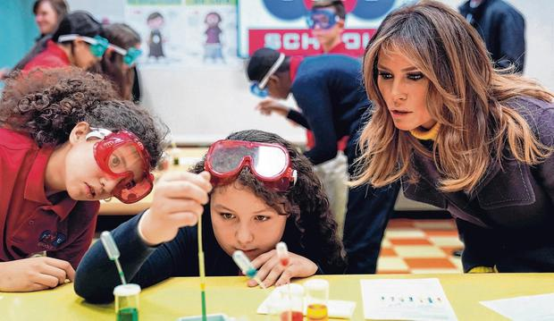 Appliance of science: US. first lady Melania Trump watches a science experiment at the Dove School of Discovery yesterday. Photo: Kevin Lamarque/Reuters