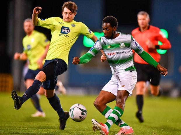 Niall McGinley tries to block a cross from Shamrock Rovers' Daniel Carr. Photo: Eóin Noonan/Sportsfile