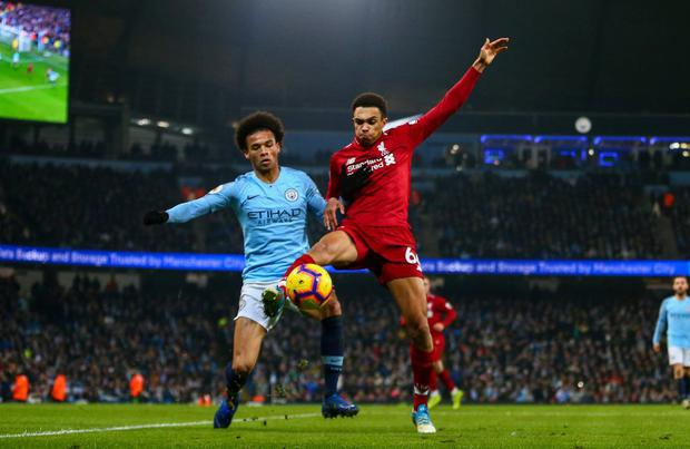 Manchester City's Leroy Sane battles it out with Liverpool's Trent Alexander-Arnold. Photo: Getty Images