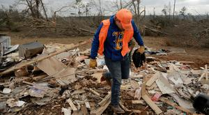 Sean Brown salvages items from the wreckage of his home following a string of tornadoes that resulted in several fatalities in Beauregard, Alabama, U.S., March 4, 2019. REUTERS/Elijah Nouvelage