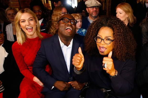 Model Karlie Kloss, left, and British Vogue magazine chief editor Edward Enninful, center, and Oprah Winfrey joke before the presentation of Stella McCartney's ready-to-wear Fall-Winter 2019-2020 fashion collection, Monday March 4, 2019 in Paris. (AP Photo/Michel Euler)