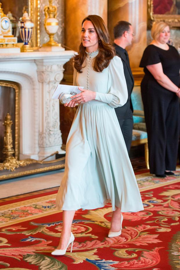 The Duchess of Cambridge attends a reception at Buckingham Palace in London to mark the fiftieth anniversary of the investiture of the Prince of Wales