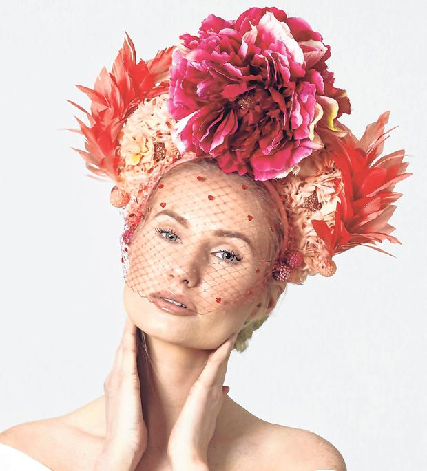 Creativity and verve: Model Katie wears a Deb Fanning floral crown with crinoline and beaded flamingos, €445.