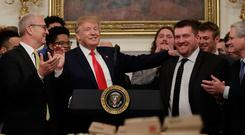 Welcome: Donald Trump greets the North Dakota State Bison football team to the White House on Monday. AP Photo/Carolyn Kaster
