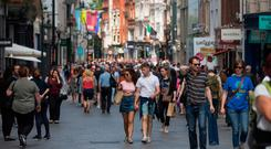 Costly: Shoppers on Dublin's Grafton Street. Many consumers do not understand how interest works on their credit card balances.